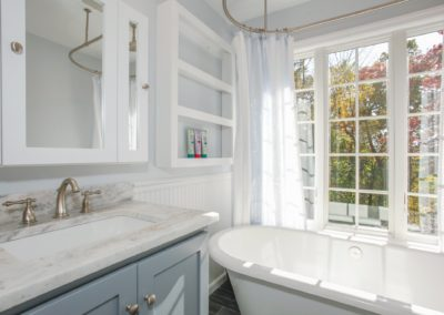 Remodeled bathroom with tub, sink, and fixtures